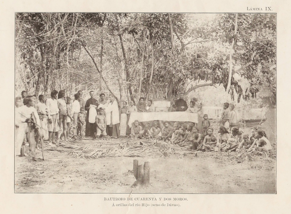 Jesuits administering baptism to natives along Davao River in 19th century. Courtesy of Jesuit Archives.